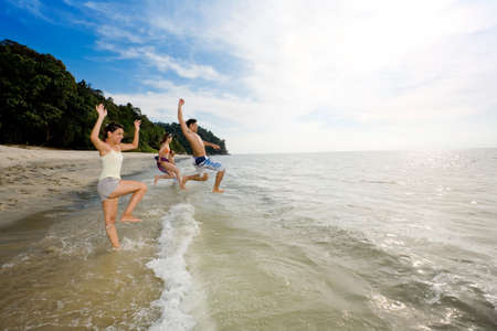 a group of friends having fun by the beach Stock Photo - 2640815