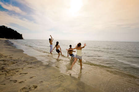 sunset beach with a group of friends having fun jumping Stock Photo - 2640807