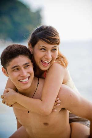 couple having fun carrying piggyback at the beach Stock Photo - 2640720