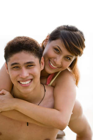 happy couple carrying piggy back Stock Photo - 2640715