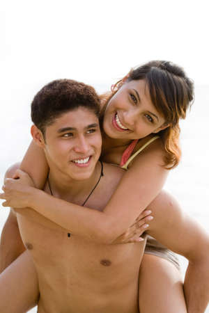 fun happy couple piggyback carrying Stock Photo - 2640718