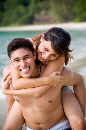 happy couple having fun on the beach Stock Photo - 2640724
