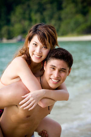 happy young couple by the beach having  time Stock Photo - 2640736