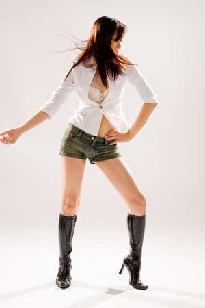 Muy sexy mujer valiente en denim shorts ajustados y botas altas  Foto de archivo - 2640869