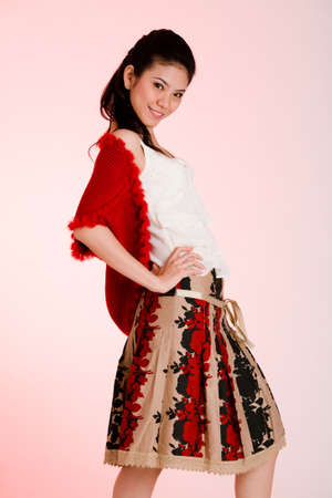 young positive girl in a white top and floral skirt and red shrg photo