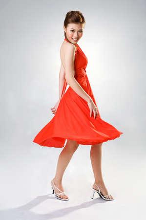 beautiful sensual woman in a red dress turnaround