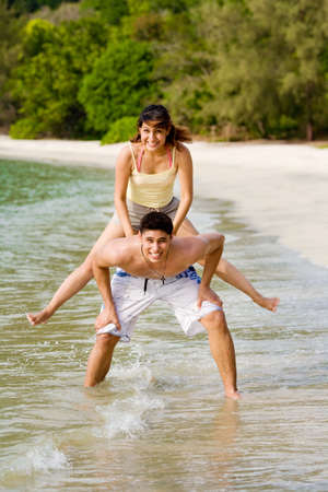 woman and man having fun hopping on the beach Stock Photo - 2680895