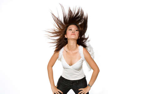 Portrait of young woman flinging here hair wildly wearing a pair of angel wings Stock Photo - 2791529