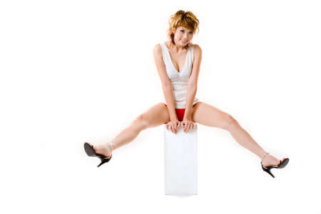 legs apart: happy sensual asan woman sitting with legs wide apart