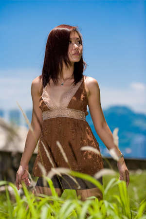 young beautiful alluring girl outdoor on a bright summer day photo
