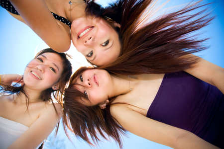 asian girls friend having good time under sunny blue sky Stock Photo