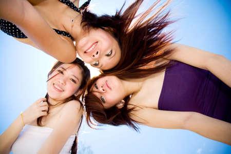 girls best friend gather around happily under bright blue sky