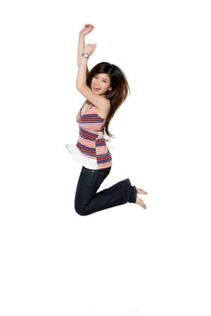 knowing: happy teenage girl jumping excitedly knowing her success