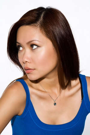 skintone: asian woman with tanned skin tone looking side way