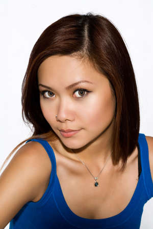 skintone: beautiful asian woman face with tanned skin tone Stock Photo