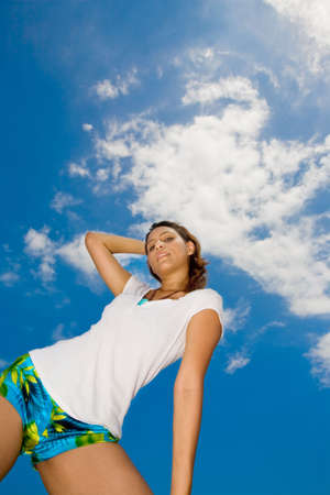 woman feeling relax looking down on sunny day with bright blue sky photo