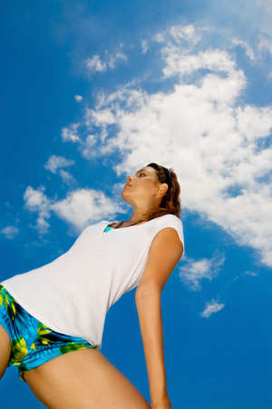 asian woman looking up to the bright blue sky photo