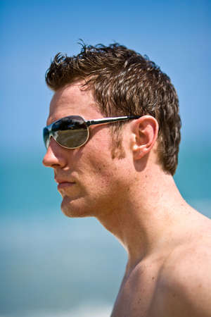 young handsome caucasian man with sunglasses Stock Photo