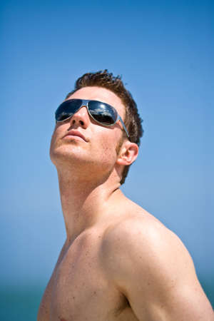 young handsome caucasian man with sunglasses photo