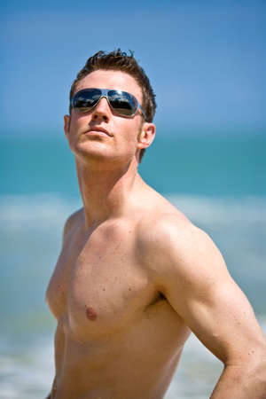 beach hunk: young handsome caucasian man with sunglasses Stock Photo