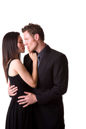 young asian woman stopping a caucasian hunk from kissing her Stock Photo - 3081700
