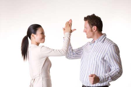 asian business woamn and caucasian man high five after a success Stock Photo