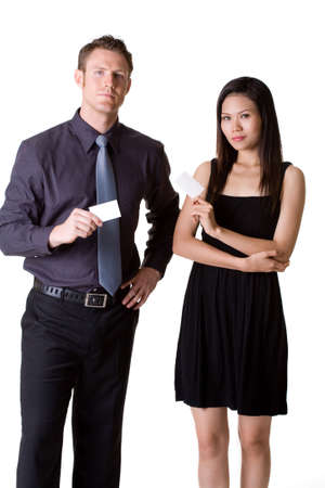 expressing: businessman in formal suit and woman in dress showing business card