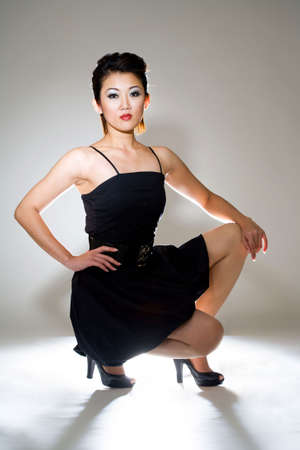 sexy asian woman in black dress with backlight Stock Photo - 3092847
