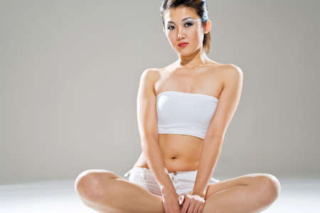 sexy and healthy chinese woman sitting on the floor photo