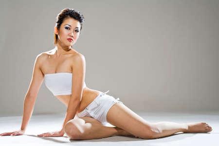 sensual asian woman sitting on the floor photo
