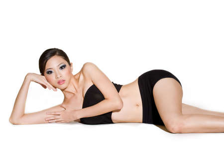 tube top: relaxing woman in black tube top and black shorts