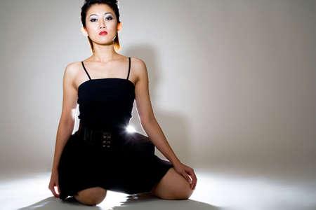beautiful backlighted black dress asain woman Stock Photo - 3199702