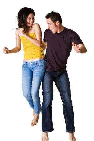 banging: causasian guy and asian woman jumping excitedly happy with hip banging