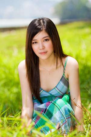 beautiful youn asian girl outdoors with lush greenery Standard-Bild