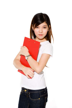 young attractive college girl holding a red file and smiling in casual clothes
