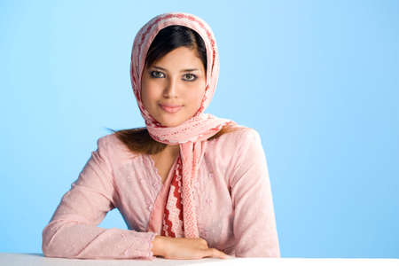 beautiful hamble young Muslim woman in head scarf and traditional wear Stock Photo