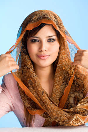 malay ethnicity: beautiful Muslim young woman in head scarf and traditional wear