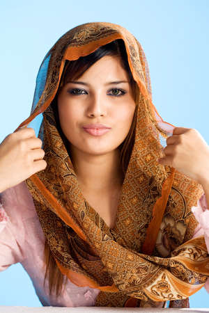 beautiful Muslim young woman in head scarf and traditional wear
