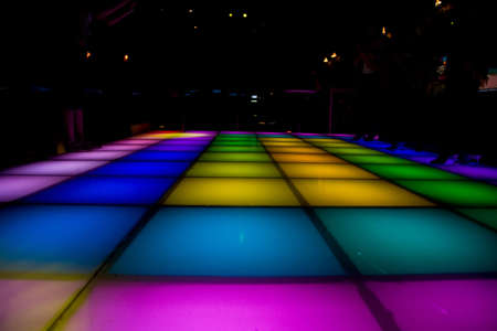 disco dance floor with different color of light glowing