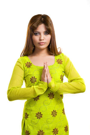 asian Muslim young woman wearing traditional Punjabi clothe green in color photo