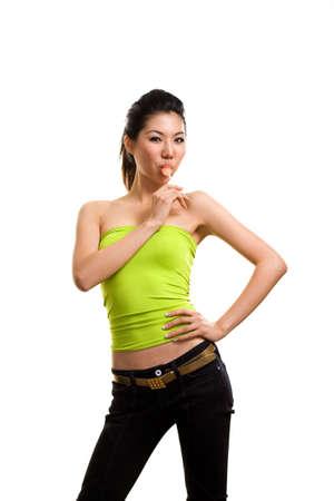 young asian woman having fun eating lollipop