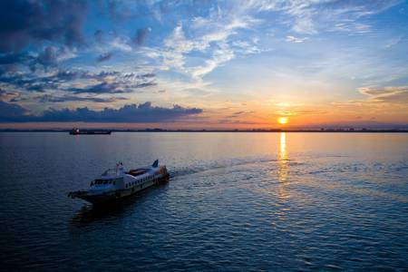 beautiful sunrise at the sea horizon with a boat in front Stock Photo - 3558013