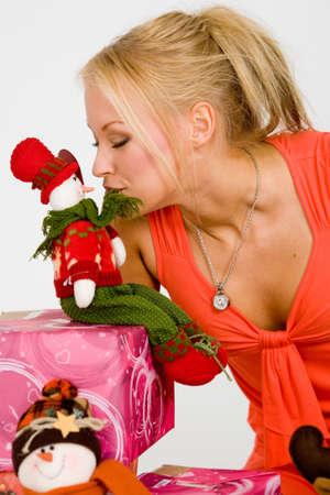 blond woman kissing a christmas doll photo
