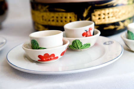 chinese tea cup: traditonal chinese tea cup set with floral painting on it