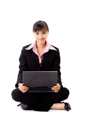 pleasant looking asian business woman sitting with a laptop Stock Photo - 3641309