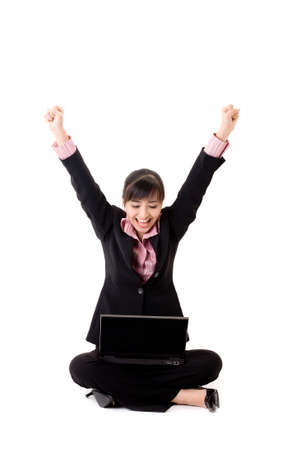 pleasant looking asian business woman sitting with a laptop with arms stretch out Stock Photo - 3641308