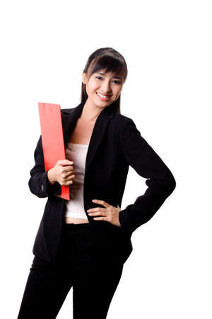 smiling female executive holding a red file photo