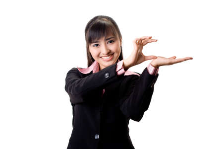 young beautful female execuitve in suite presenting with her hands Stock Photo - 3640987