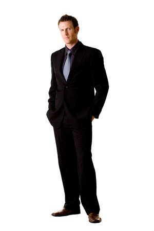 serious looking caucasian man in suit and tie with hand in the pocket photo