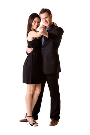 a couple in black dancing and feeling very happy